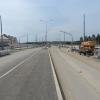 Дорога, тротуары и съезды: ход строительства I этапа улицы Амундсена в сторону ЕКАД
